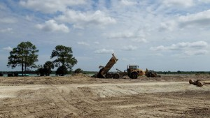 """A construction site in Punta Gorda, Florida is seen April 22, 2016, where builders will erect homes and shopping areas for Babcock Ranch, a sustainable, eco-friendly city that will house 50,000 people and opens to the public in 2017.  With deep pockets and an environmentalist's zeal, retired American football player Syd Kitson dreamed up a plan to build the United States' first solar-powered town on a vast swath of rural land in southwest Florida. Nearly a decade after he first purchased the 91,000 acres (37,000 hectares) known as Babcock Ranch, construction is bustling at what developers say will be the nation's first eco-friendly city, built from the ground up, with enough room for some 50,000 people.  / AFP PHOTO / Kerry SHERIDAN / TO GO WITH AFP STORY BY KERRY SHERIDAN-""""Construction is bustling at Florida's first 'sustainable town"""""""